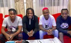 Naira Marley signing zinoleesky